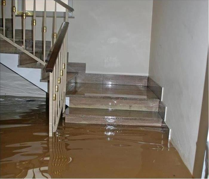 Why SERVPRO - image of flooded stairs