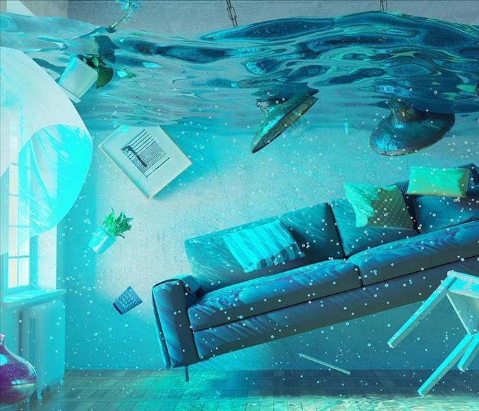 A living room full of water up to the ceiling.